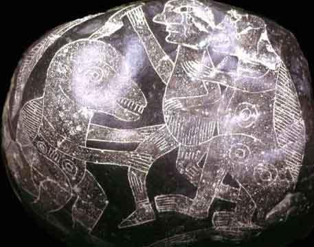 Камни с рисунками, где люди сражаются с динозаврами